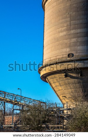 Industrial tank at a chemical works. - stock photo