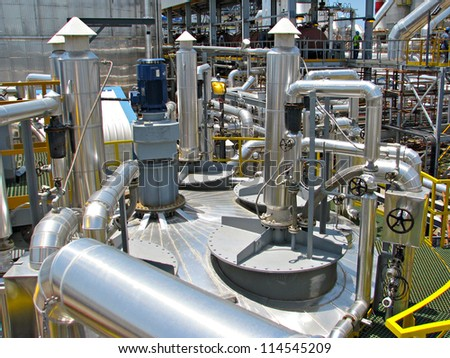 industrial tanks, pipes, pump, instrumentation - stock photo