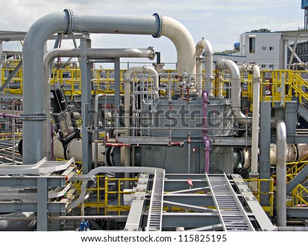 Industrial tanks, pipes, pumps, instrumentation, motor, cable racks, - stock photo