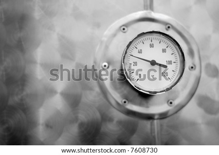 industrial temperature meter for liquids, selective focus on round thermometer