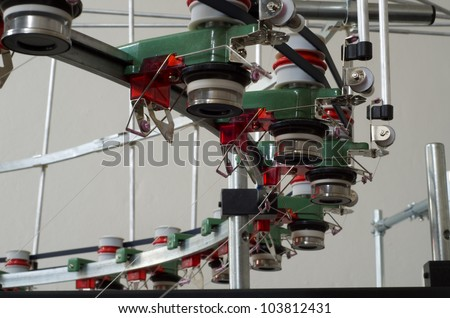 Industrial textile manufacture weaving machine with motion blur - stock photo