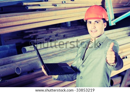 Industrial theme: a blue collar working at a manufacturing area. - stock photo
