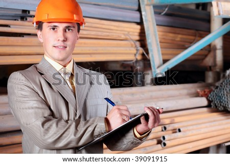 Industrial theme: a blue collar working at a manufacturing area.
