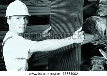 Industrial theme: a worker at a manufacturing area. - stock photo