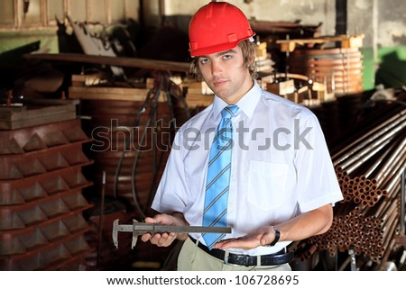 Industrial theme: manager at a manufacturing area. - stock photo