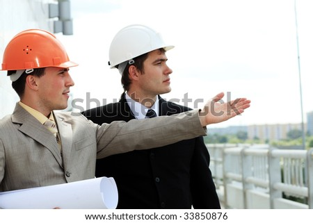 Industrial theme: two blue collars at a site area. - stock photo
