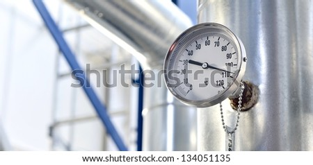 industrial thermometer in boiler room - stock photo