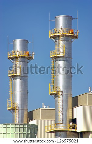Industrial Towers in a power plant facility - stock photo
