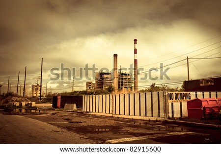 Industrial, toxic landscape of abandoned smoke stacks and waste removal plant - stock photo