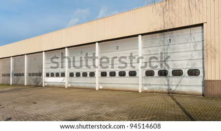 industrial unit with old and damages roller shutter doors
