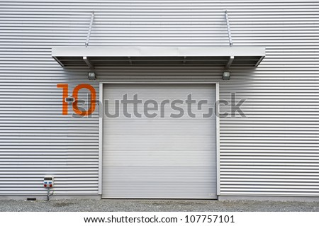 Industrial unit with roller shutter door. - stock photo