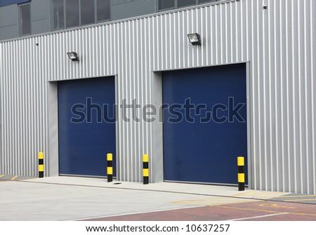 Industrial Unit with steel roller shutter doors - stock photo