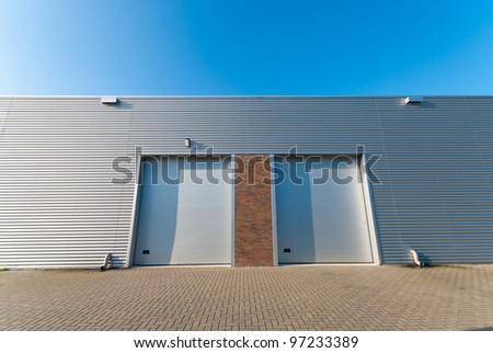 industrial unit with two roller doors - stock photo
