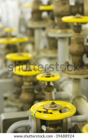 industrial valves in engine room - stock photo