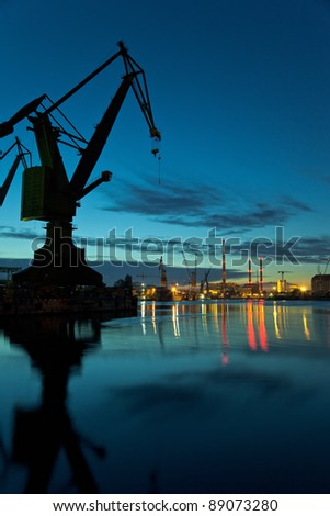Industrial view at night in shipyard of Gdansk, Poland. - stock photo