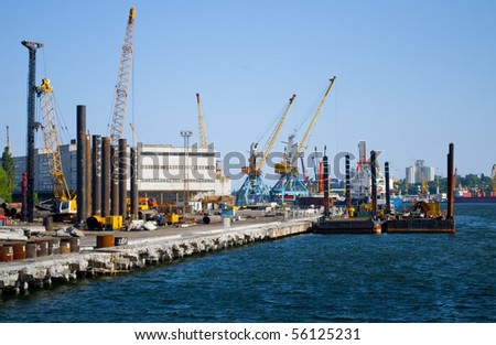 Industrial view: factory, cranes, ships, containers