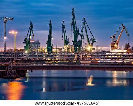 Industrial view of the Gdansk Shipyard at night, Poland. - stock photo