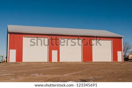 industrial warehouse. Industrial Unit with roller shutter doors . Steel building - stock photo