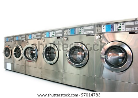 industrial washing machines in a public laundromat - stock photo