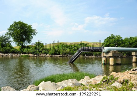 Industrial Waste Water Outfall and Collection Pond - stock photo