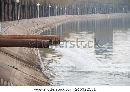 Industrial wastewater discharged into the river - stock photo