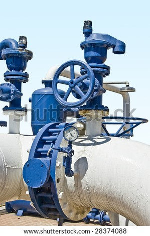 Industrial water pipes with safety and bypass valves. - stock photo