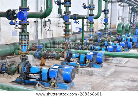 Industrial water pump station -- Pumps and pipelines within the water treatment plant  - stock photo