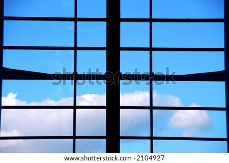 Industrial window with bright blue daytime sky