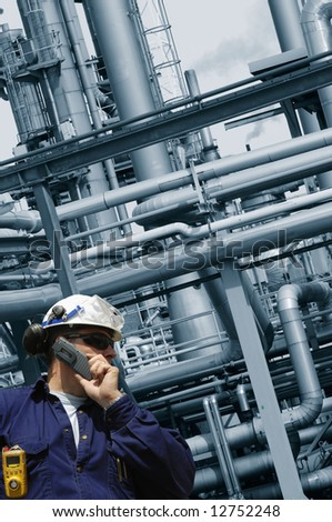 industrial worker and oil refinery pipelines - stock photo