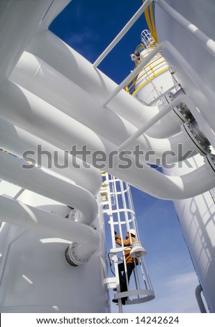 Industrial Worker at an oil and gas processing plant - stock photo