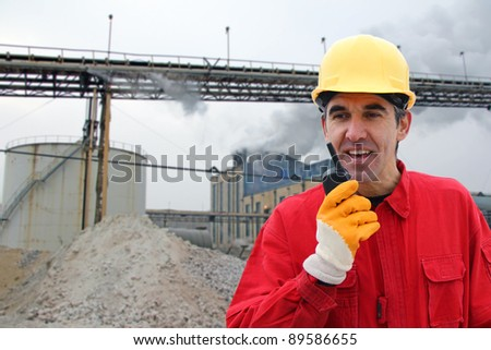 Industrial Worker, controls work in a factory - stock photo