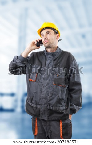 industrial worker in action on blurred background - stock photo