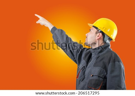 industrial worker in action on solid background - stock photo