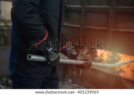 Industrial worker in metal melting factory