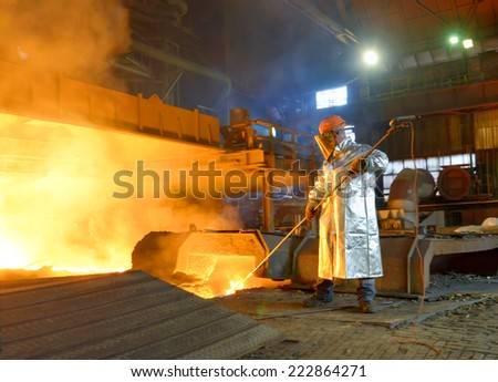 Industrial worker in steel making factory - stock photo