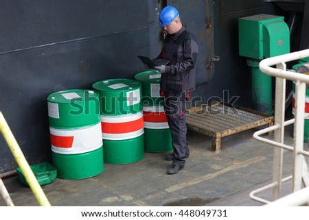 Industrial worker inspecting the facilities of a plant. - stock photo