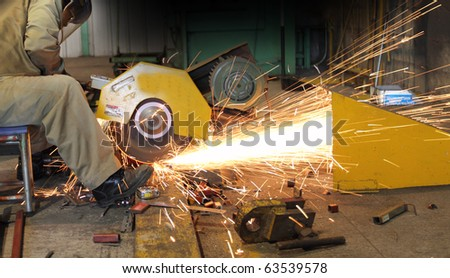 Industrial worker make spark - stock photo