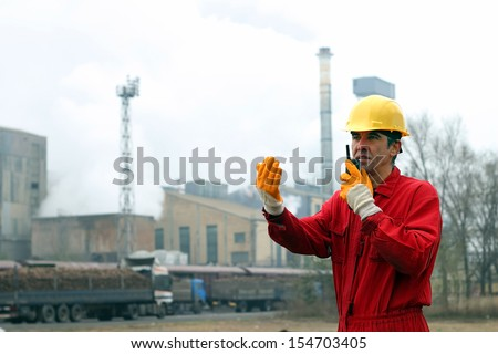 Industrial worker. Sugar Refinery Plant. Portrait of a worker using walkie-talkie in sugar refinery. - stock photo