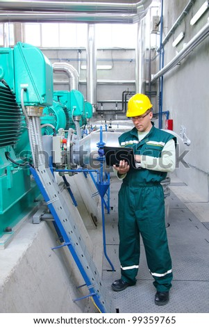 Industrial worker with notebook - stock photo