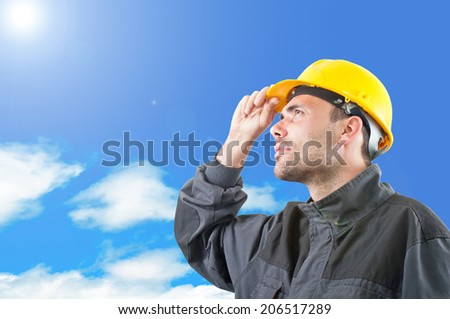 industrial worker with yellow helmet facing high
