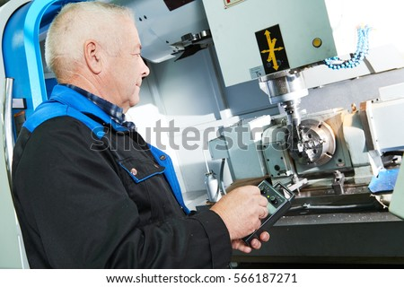 industrial worker working with cnc milling machine