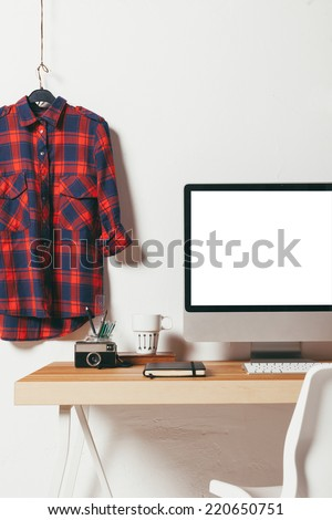 Industrial workspace with computer. / Closeup of minimal office on white background.  - stock photo