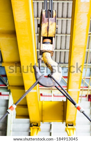Industrial yellow crane and  hook - stock photo