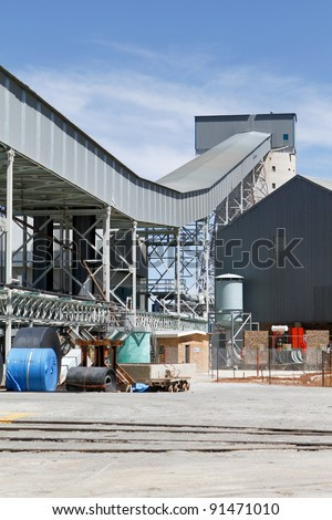 Industrial zone conveyor belt system on gold mine South Africa - stock photo