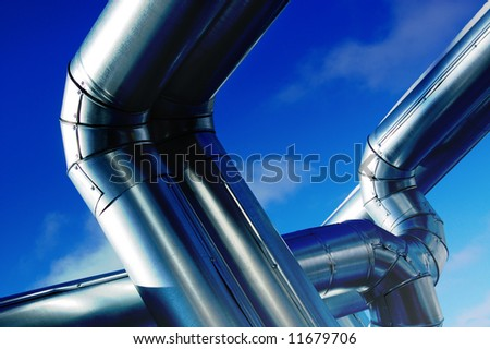 Industrial zone, Steel pipe-lines on blue sky - stock photo