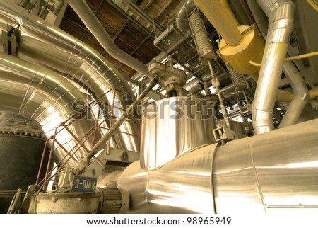 Industrial zone, Steel pipelines and cables in yellow tones - stock photo