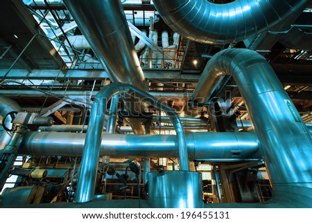 Industrial zone, Steel pipelines and equipment in blue tone - stock photo