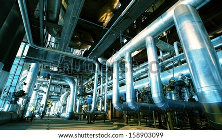 Industrial zone, Steel pipelines and valves in blue tones - stock photo