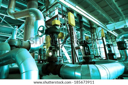Industrial zone, Steel pipelines and valves in blue tones