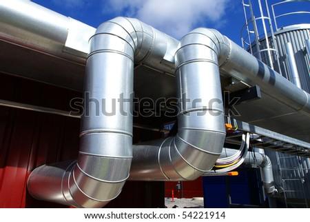 Industrial zone, Steel pipelines on blue sky - stock photo